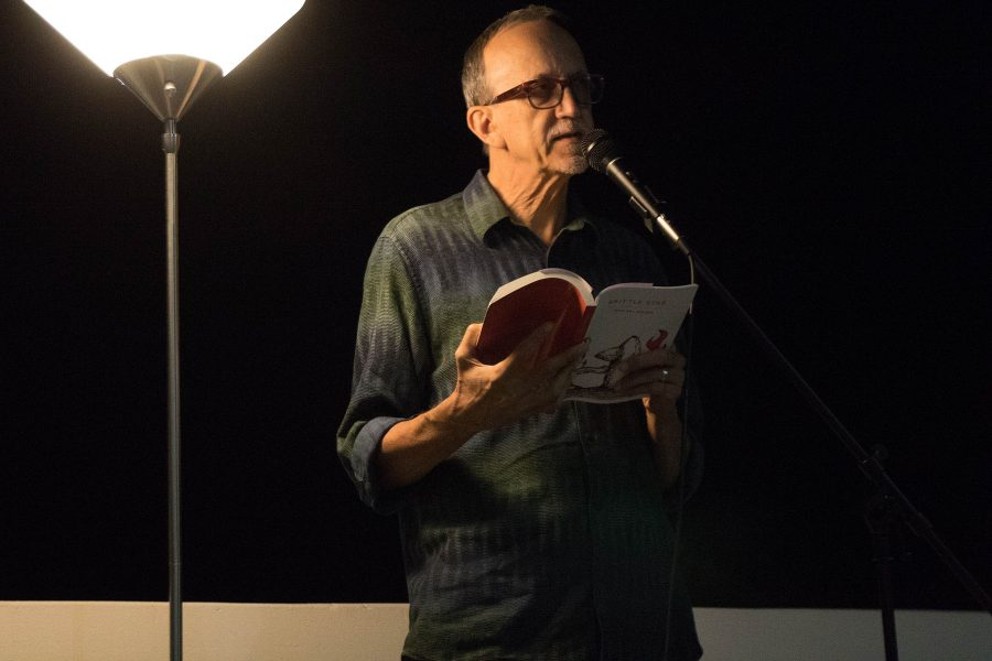 "Rod Val Moore, author and member of What Books Press, reads an excerpt from his novel ""Brittle Star"" at a collective reading performance on Thursday, Oct. 20, on the balcony of the Atkinson Gallery. City College's creative writing department and Gunpowder Press sponsored the reading."