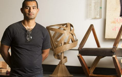 Armando Ramos stands with student sculptures on Monday, Oct. 3, in his lab in the Humanities Building at City College. Ramos is the new arts instructor who specializes in 3D sculptures made from all different types of material, such as wood and cardboard.