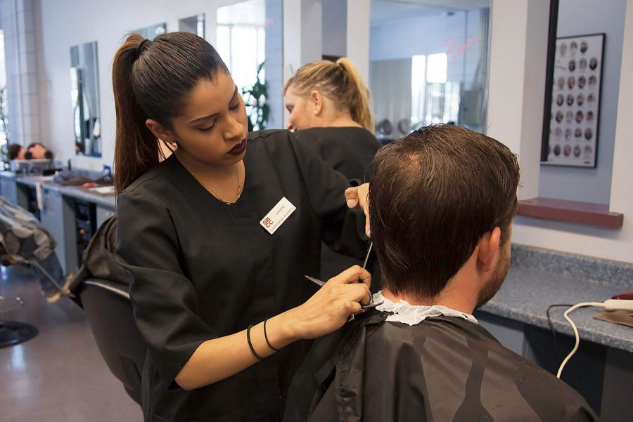 Lorena+Almanza+cuts+a+clients+hair+for+%245+to+raise+money+for+the+Surf+Rider+Foundation+on+Sunday%2C+Oct.+2%2C+at+City+College%E2%80%99s+Cosmetology+Academy+in+Goleta.+All+proceeds+went+to+the+foundation+to+help+protect+the+communities%E2%80%99+coastal+environment.