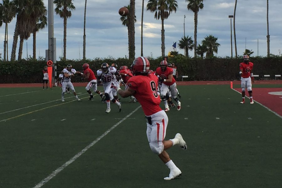 Joseph Osegueda (No. 14), Vaquero fourth string quarterback, completes a pass to running back Cedric Cooper (No. 9) for a 15-yard gain during the second quarter on Saturday, Oct. 29, at La Playa Stadium. City College defeated Citrus College, 46-44, in double overtime.