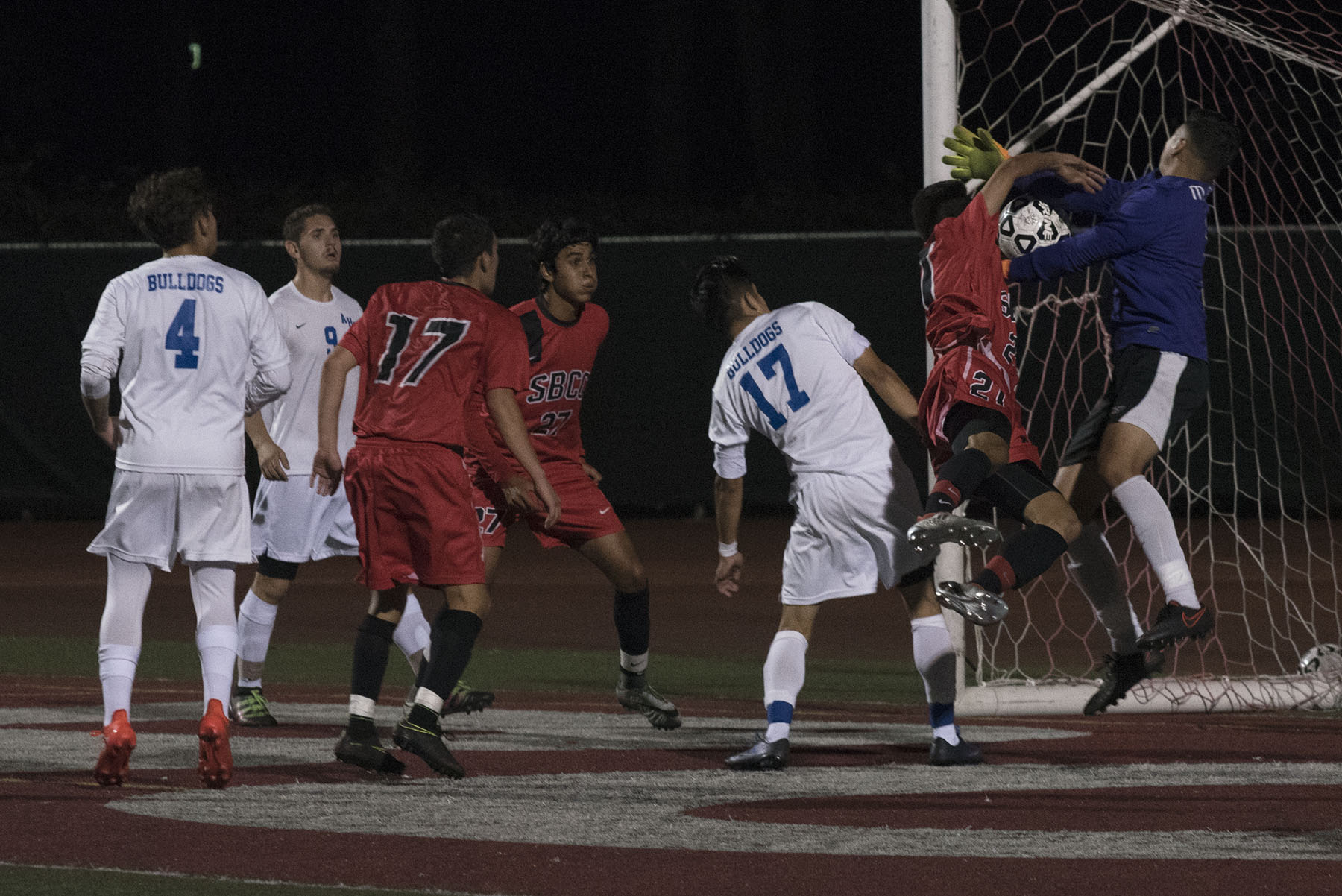 Vaquero defender Nicolas Genthon (No. 21) gets tangled up with Bulldog goalie Migel Gomez (No. 1) while trying to score on Tuesday, Oct. 11, at La Playa Stadium. City College defeated Allan Hancock College, 2-0.