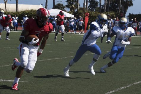 Elijah Cunningham runs past West Los Angeles College defenders to score a touchdown on Saturday, Sept. 10 at La Playa Stadium. Cunningham is an explosive receiver, kick and punt return specialist and nephew of Philadelphia Eagle Hall of Fame quarterback Randall Cunningham.