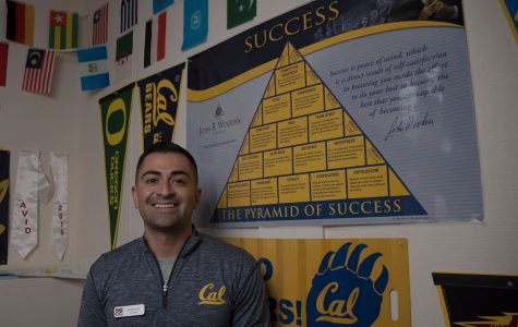Andrew Gill's office walls are covered with university banners and small foreign country flags on Thursday, Oct. 13, at City College. Gill was recently hired as a second full-time counselor for the Express to Success Program.