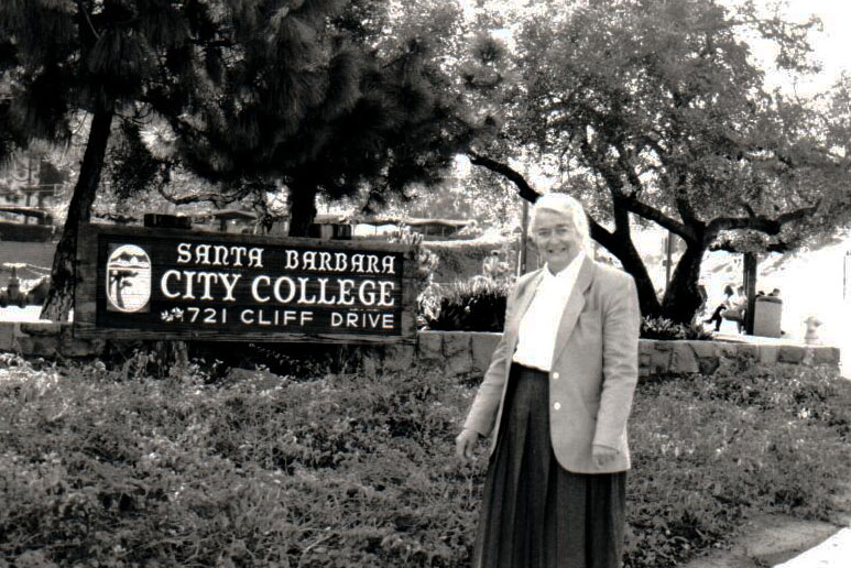 Dr. Kathryn 'Kay' Alexander stands in front of City College's Main Campus.