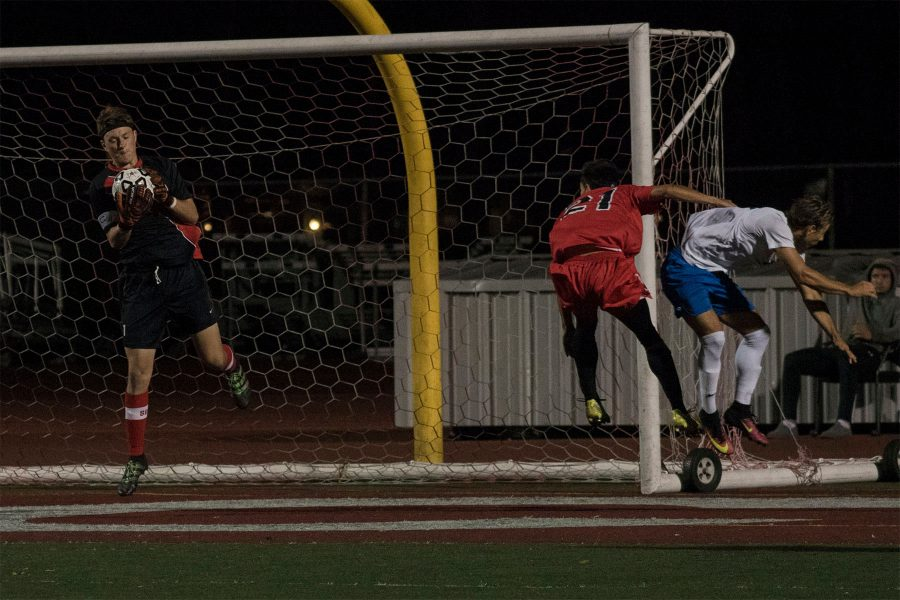 Vaquero goalkeeper Shane Pitcock (No. 1) makes a save after Corsair forward Romario Hulea (No. 9) attempts a shot on goal on Tuesday, Oct. 25, at La Playa Stadium. City College defeated Santa Monica College, 2-1, and improves to 8-6 overall and 3-2 in league play.