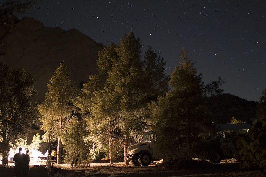Lanterns light up the camping area for dinner as students look up at the stars on Friday, Sept. 30, in the Cuyama Badlands, north of Ojai. Geology club members and instructors spent one night exploring the badlands to collect rock samples and fossils.