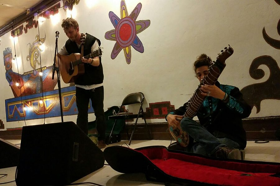 Michael Sallstrom (left) and Maz Karandish perform together for Santa Barbara Stands with the Standing Rock Thursday, Nov. 17, at Case de la Raza in Santa Barbara. The event was organized by Gabriella Hernandez as a way to raise money for supplies for the protesters.