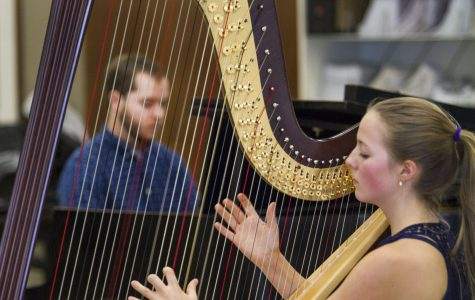 Harpist Ginger Brucker and Pianist, Wyatt Dale perform 'Triplets' on Friday afternoon, Nov. 4, at the City College Music Salon. 'Triplets' is an original student composition written by Music Student, Amin Sarrafi (not pictured) and Brucker.