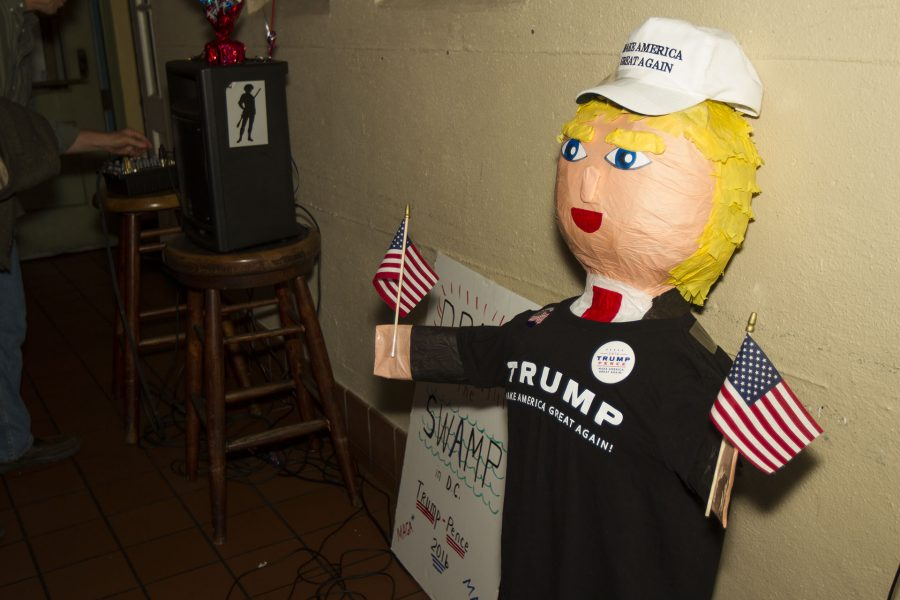 "A Donald Trump pinata sits under the television broadcasting live election updates on Tuesday evening, Nov. 8, at The Endless Summer bar-cafe during the Young Republican election party in Santa Barbara. The President of the Young Republicans, Bobby Mercado said ""I didn't think it was going to happen,"" about Donald Trump winning the presidency."