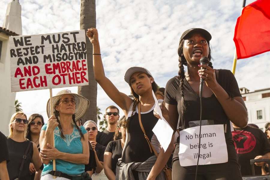 Akilah Simone Baker, a speaker from the Black Lives Matter movement, gives a speech during the united against hate march against Donald Trump, on Saturday, Nov. 12, at De La Guerra Plaza in Santa Barbara. The press release about the event said, 'Since Donald Trump began his campaign in 2015, the KKK and other violent white supremacist groups have had a resurgence.'