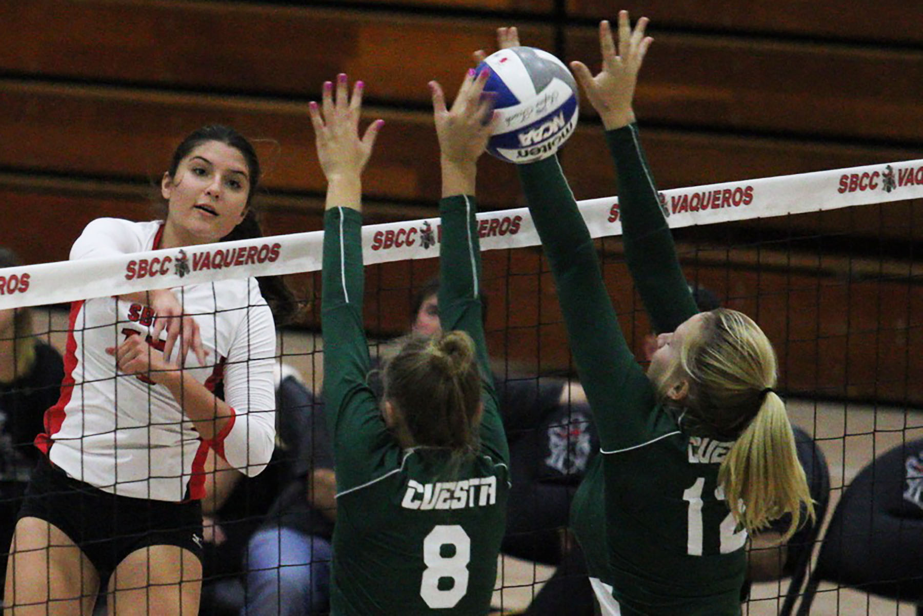 Vaquero Outside Hitter Carolyn Andrulis (No. 15) spikes the ball against Cougars Kelly Cole (No. 8) and Morgan Lawson (No. 12) on Wednesday, Nov. 2, in the Sports Pavilion. City College conquered Cuesta College 3-0.