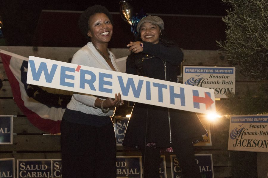"""Charlotte Gullap-Moore (left) and Breyanna Carter show their support for Clinton at the Democrat election party on Tuesday, Nov. 8, at The Mill Restaurant and Brewery in Santa Barbara. """"If you say that Trump is in the best interest of our Country then you are in a warped reality,"""" says Gullan-Moore."""
