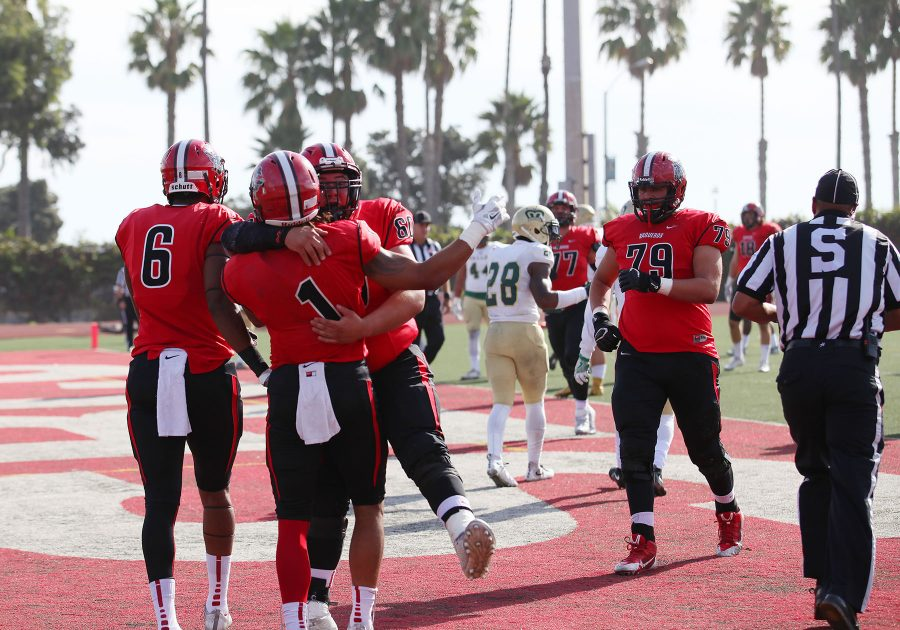 Sophomore Elijah Cunningham (No.1) celebrates with his teammates after a touchdown in the second quarter against LA Valley on Nov. 12, at City Colleges La Playa Stadium. The Vaqueros lost the game 47-35.