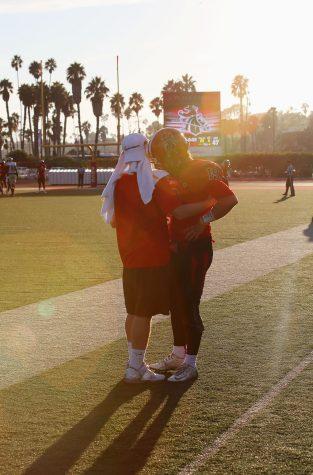 Sophomore Timothy Milliken (No.19) shows his sad emotions with his friend after The Vaqueros lose the game 47-35 to LA Valley on Nov. 12, 2016 at Santa Barbara City College, La Playa Stadium.