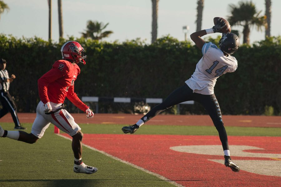 Moorpark+wide+receiver+Emmanuel+Osuchukwu+%28No.+14%29+scores+their+only+passing+touchdown+against+the+Vaqueros+during+the+Beach+Bowl+on+Saturday%2C+Nov.+19%2C+at+La+Playa+Stadium.+The+Vaqueros+lost+the+final+game+of+the+season+49-12.