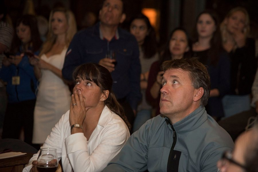 Stephanie Linder and Eamon O'Byrne watch as election results come in during the democrat election party on Tuesday, Nov. 8, at The Mill in Santa Barbara. As the news came in that Donald Trump would likely be the president they joked that they might move back to Ireland.
