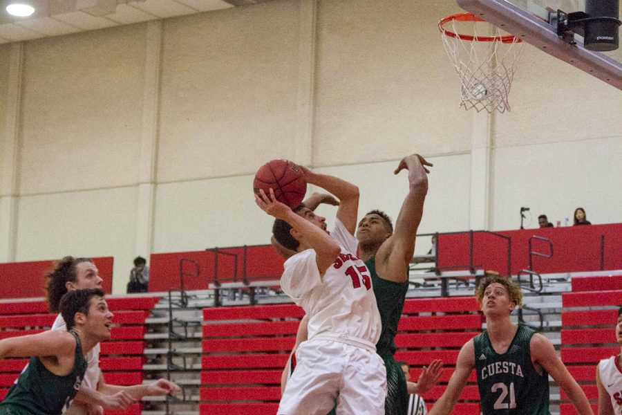Robert Hutchins (No. 15) of the City College Vaqueros attempts to break a tied score in the first half of the game against the Cuesta City College Cougars held on Saturday, Feb. 4 in the Sports Pavilion. The Cougars won the game with a final score of 86 to 77.