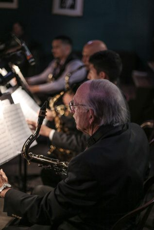 Saxophone players in the City College Good Times Big Band prepare for a show on Monday, Feb. 13, 2017, at SOhO Restaurant and Music Club in Santa Barbara, Calif.