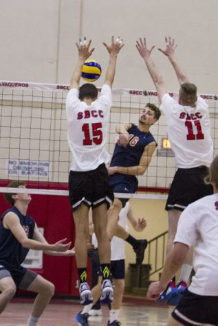 City College Vaqueros, Jarret Futch (No. 15) and Sean Reynaert (No.11) attempt to block a kill by Orange Coast College Pirate, Jordan Hoppe (No.16) on Wednesday, Feb. 8, 2017, in the sports pavilion at Santa Barbara City College. According to Futch, the Vaqueros have not beaten the Pirates in a set in four or five years.