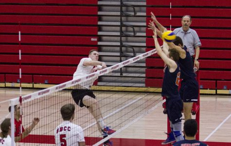 City College Vaquero Sean Reynaert (No.11) kills the ball at the beginning of set two against the defence from the Orange Coast College Pirates, Matt Ujkic (No. 7) and Bradley Hankus (No. 24) on Wednesday, Feb. 8, 2017, in the sports pavilion at Santa Barbara City College. At the beginning of set two, the Vaqueros took the lead 2-1, but the Pirates caught up and won the set, 25-12.