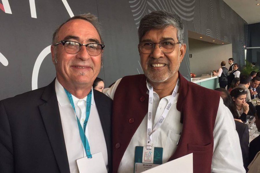 Kailash Sathyarthi, nobel peace laureate 2014, and Philosophy Professor Joseph White at the 16th World Summit of Nobel Peace Laureates in Bogota, Colombia.