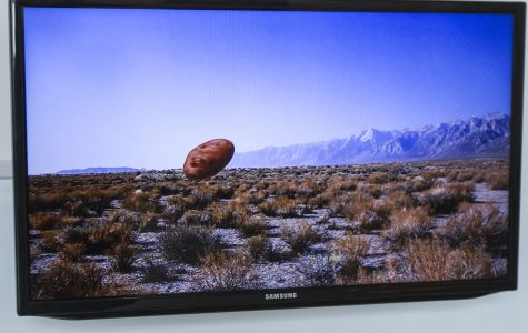 """Stephanie Washburn's video piece, """"Idaho"""" on Monday, Feb. 27, at the Atkinson Gallery. The Video depicts a landscape of Idaho, and at one point throughout the video a potato floats through the screen."""