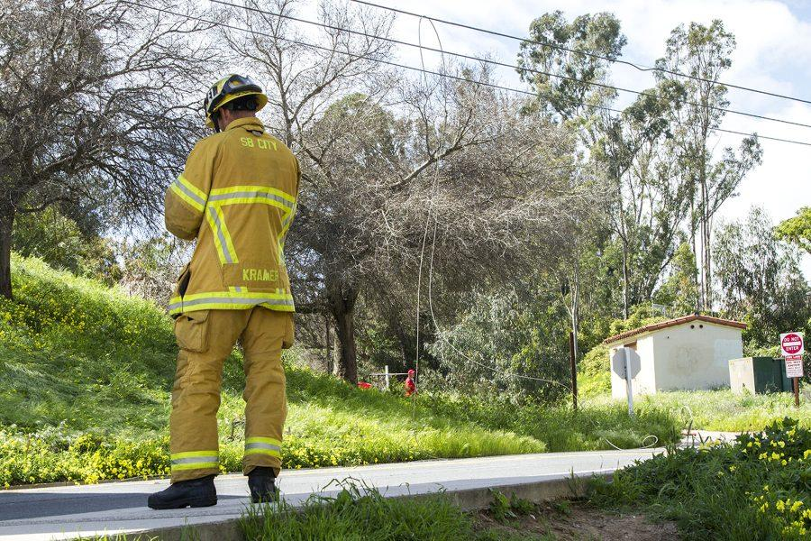 A Santa Barbara City Fireman on Loma Alta Drive after the power line snapped causing City College and neighboring areas to lose power Wednesday, March 22, at City College. The Bridge between East and West Campus was closed after a small fire from the downed power lines.