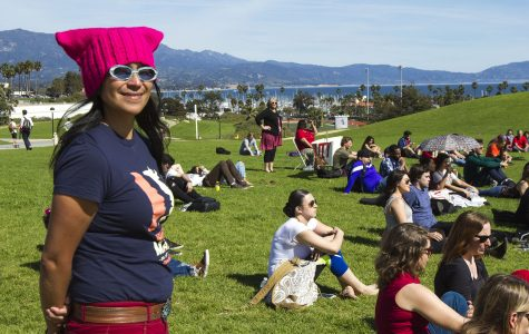 "English Professor Melissa Menendez attends the ""International Women's Day: A Day Without Women!"" event on Wednesday, March 8, on the West Campus Lawn. Mendez coordinated the event and more than 30 people spoke on various topics including women's rights, immigration, and LGBT rights."