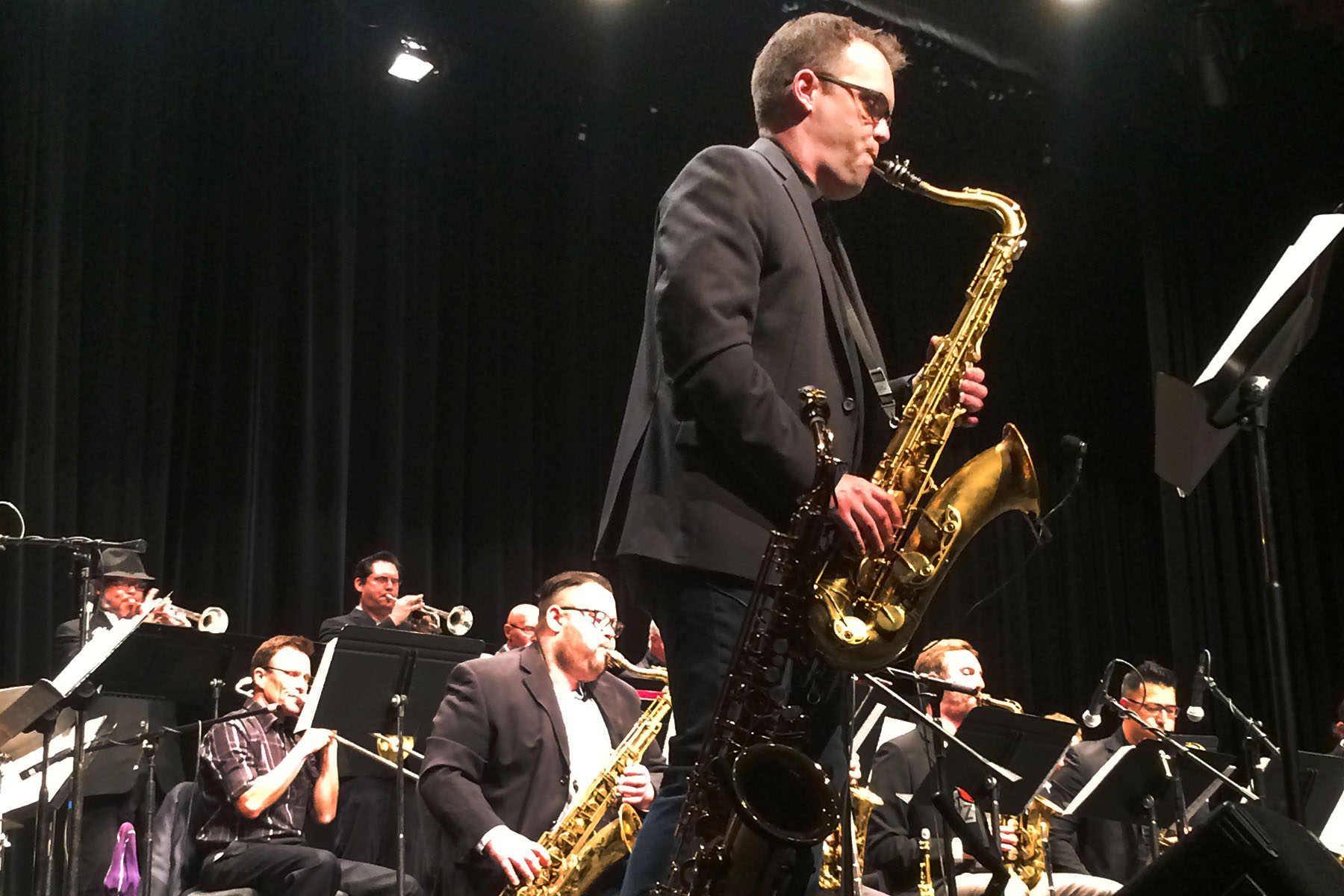 """Kevin Garren, grammy winning saxophonist and City College alumnus, performs the song """"Bopularity"""" by Matt Catingub during the Legends of Jazz concert on Friday, April 7, at the Garvin Theatre. Garren Played with all three City College Jazz Bands."""
