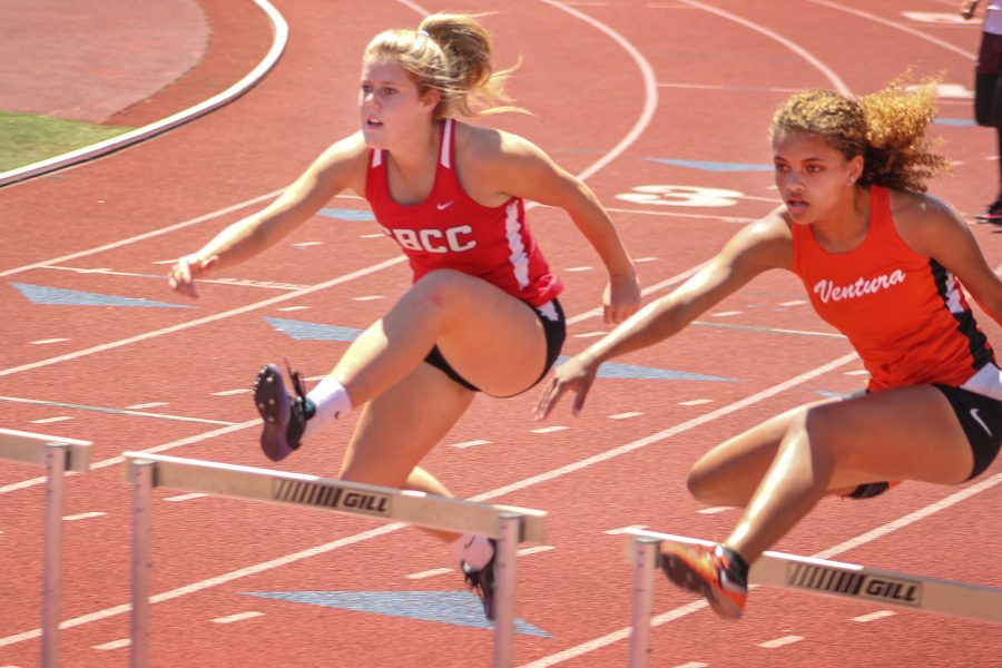 Madison Blaes hurdles in the 100 meter hurdle at the City College Easter Open track meet on Friday, April 14, at La Playa Stadium. Blaes finished 15th overall with a time of 18.42 seconds.