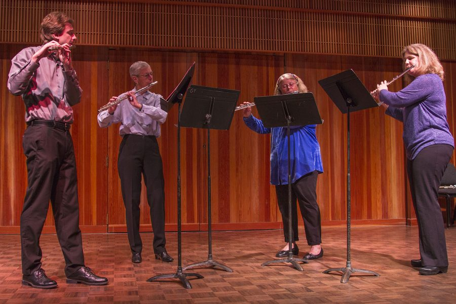 "The Flute Quartet Trevor Dolin, Karen Dutton, Pamela Romani and Meredith Sedwick perform three pieces at the Chamber Winds Concert on Sunday, March 19, at the Fé Bland Forum. They played ""Carinhoso Traditional"" by Alberto Arantes, ""Elegy"" by Joseph Jongen, and ""The Salt of the Earth"" by Catherine McMichael."
