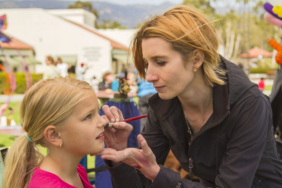 Madison Bryson, 9, has her face painted by Stephanie Mings at the Santa Barbara Kite Festival on Sunday, April 9, on West Campus at City College.