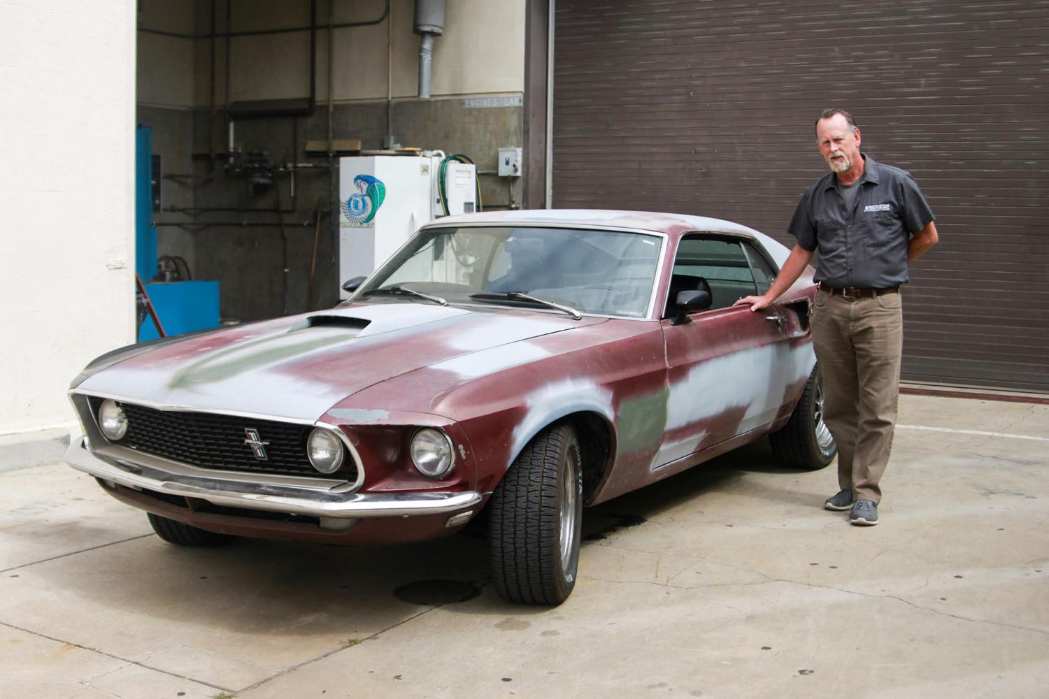 Robert+%22Bob%22+Stockero%2C+automotive+technology+department+chair%2C+poses+with+his+1969+Mustang+Fastback+on+Wednesday%2C+April+12%2C+at+the+City+College+auto+yard.+The+classic+car+is+one+of+the+vehicles+Stockero+will+work+on+restoring+during+his+retirement.