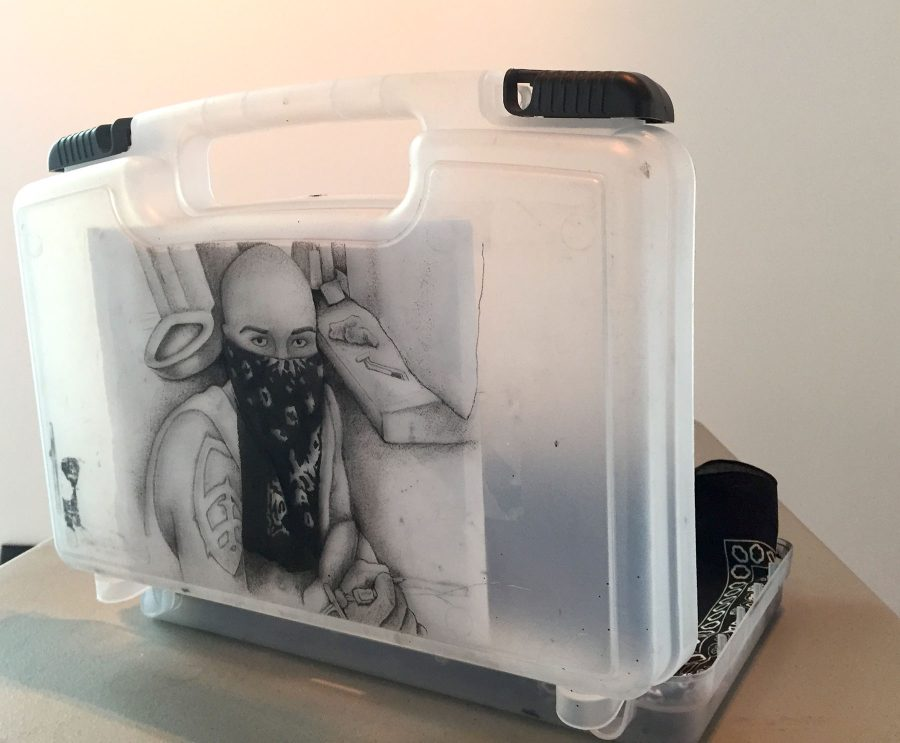 Courtesy art of the Student Art Exhibition. Alberto Lule, Self-Portrait in Prison, Tattooed ink on art kit
