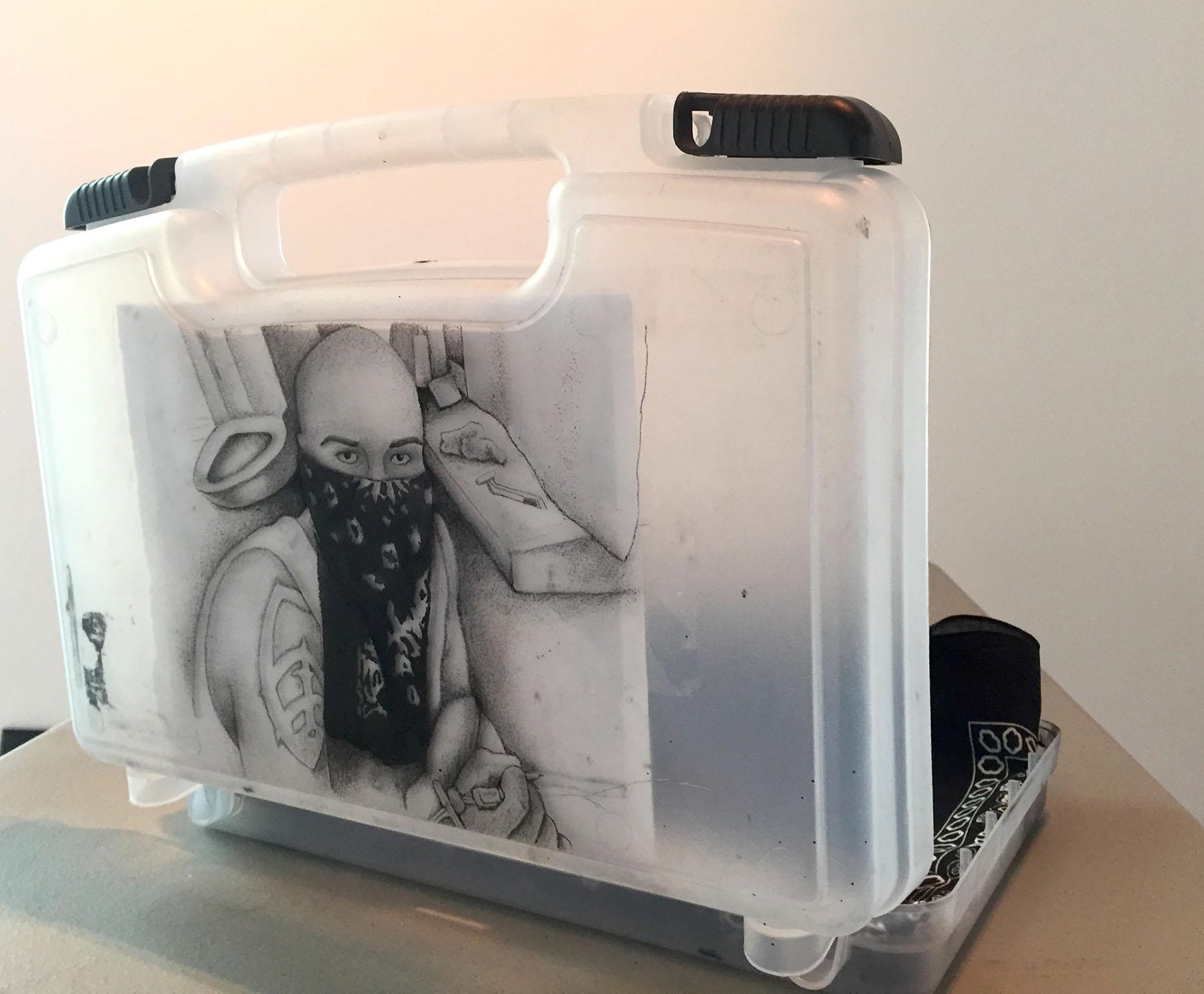 Courtesy art of the Student Art Exhibition. Alberto Lule, Self-Portrait in Prison, Tattooed ink on art kit