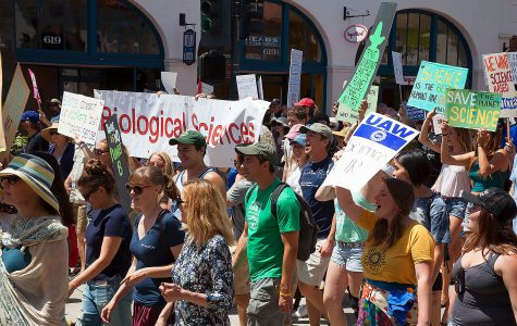 City College Biology Club walk down State street during the March For Science Day on Saturday, April 22, at De La Guerra Plaza in Downtown Santa Barbara.