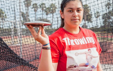 Freshman Alana Ochoa in front of the throwing cage with a discus on Monday, March 20, at La Playa Stadium. Ochoa won Javelin, shot put, discus and hammer at her very first College track meet.