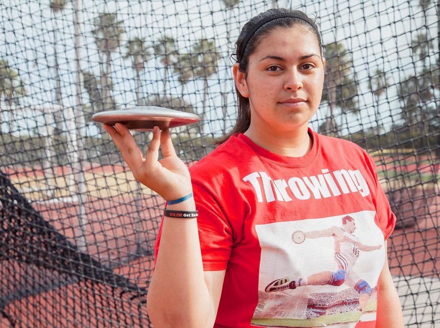 Freshman+Alana+Ochoa+in+front+of+the+throwing+cage+with+a+discus+on+Monday%2C+March+20%2C+at+La+Playa+Stadium.+Ochoa+won+Javelin%2C+shot+put%2C+discus+and+hammer+at+her+very+first+College+track+meet.