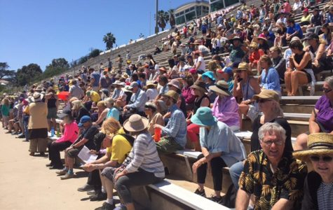 "People gather for the ""People's Climate March"" on Saturday, April 30, at La Playa Stadium. People marched to raise awareness about climate change and promote clean energy."