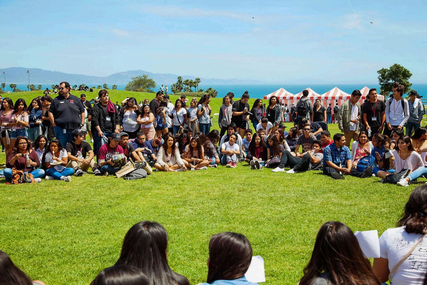 """High school students and City College volunteers sit together listening to students life stories and a music performance at the """"High School Equity and Leadership Conference"""" on Friday, April 28, on West Campus. Students were from the local high schools, Dos Pueblos, San Marcos, Carpinteria, and Santa Barbara high school."""