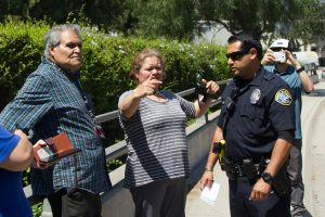 From left, Sacramento Jimenez and daughter Silvia Jimenez explain what happened to Officer Justin Cruz Monday, Aug. 28, 2017, on Cliff Drive near Santa Barbara City College. Silvia translated her fathers account of the five-car pile up.