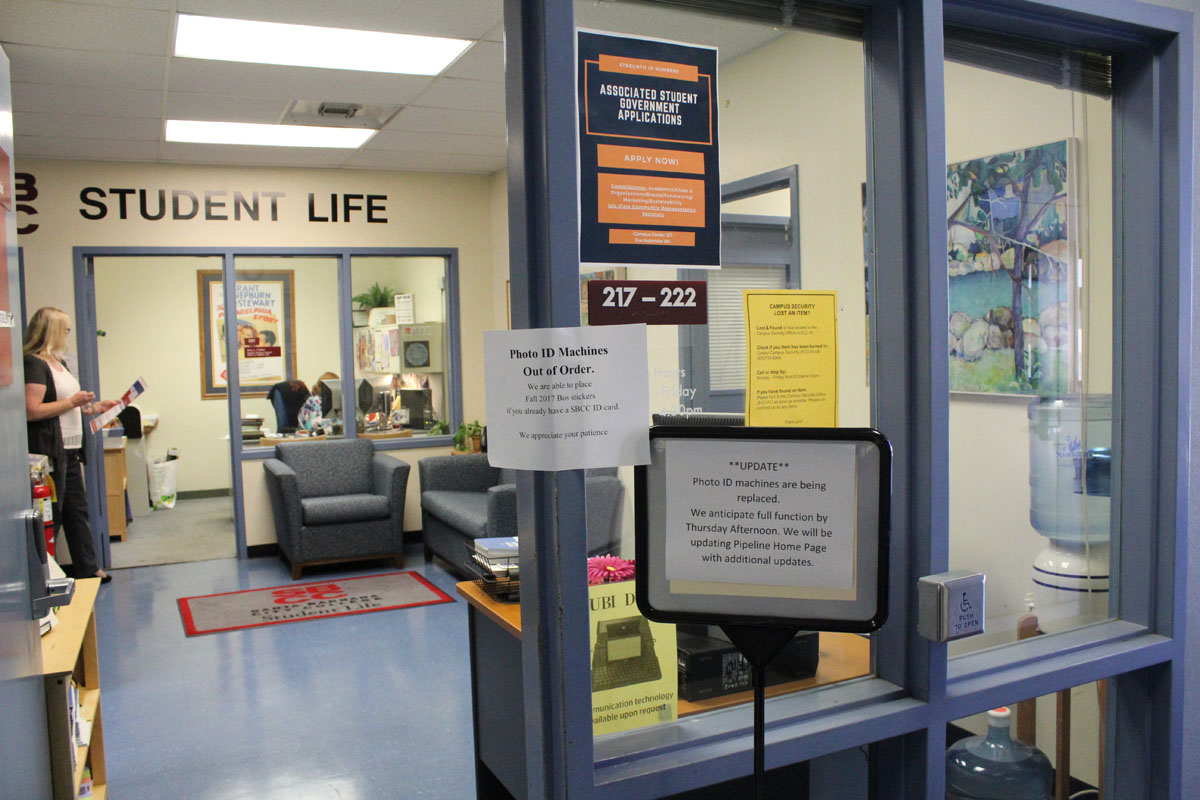 Signs informing students that student ID machines are broken the first week of school, Aug. 23, 2017, at the Office of Student Life at Santa Barbara (Calif.) City College. The office anticipates the machines to be fully functional by Aug. 24.