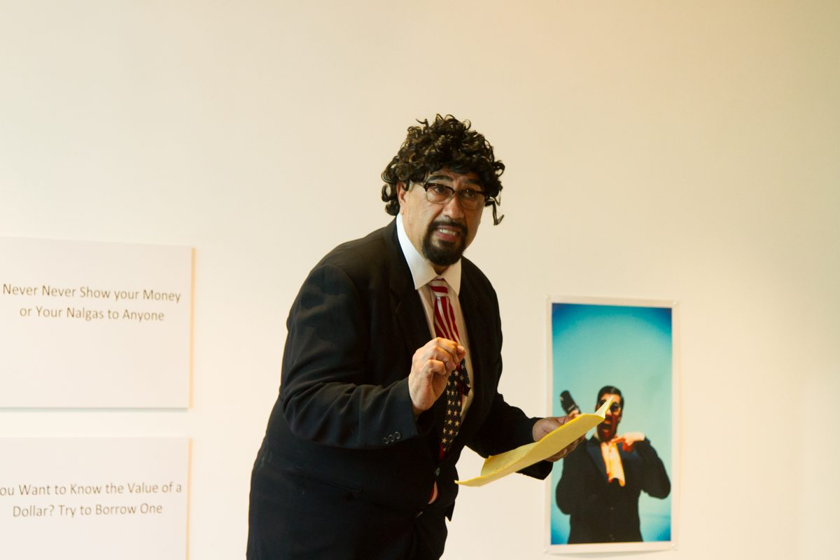Tomas Carrasco performs a comedy act playing as a Chicano politician at his art show Thursday August 31, 2017 in the Atkinson Gallery. Carrasco is a professor at City College teaching Chicano Studies.