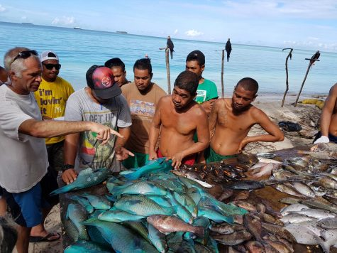 From left, Peter Nelson training fishermen from Elato Island in yap state of federated states of micronesia and on how to collect data on their fish catches.