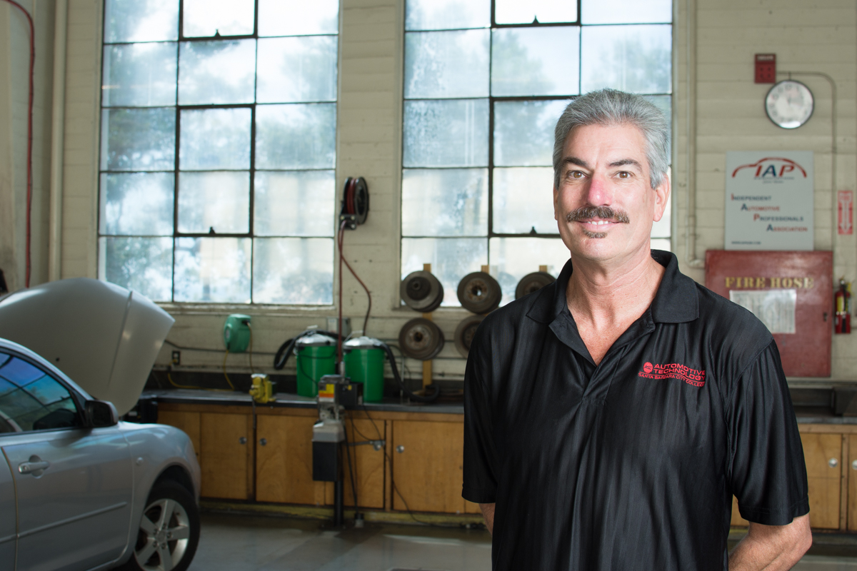 Russell Granger is the automotive department's new chair at Santa Barbara City College in Santa Barbara, Calif. on Sept. 15, 2017. Granger was teacher of the year four times at San Marcos High School where he previously taught.