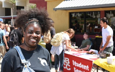 Saturne Tchabong, the team lead intern at Scheinfeld Center, staffs the table for the Black Student Union Club Thursday, Sept. 6 at the Friendship Plaza in Santa Barbara City College. Tchabong is the president of the club and was there recruiting students.