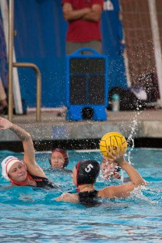 City College Center Kemi Dijkstra looks for an opening to pass to a teammate Sept. 20 at San Marcos High School in Santa Barbara, Calif. Dijkstra is a freshman at City College and is from the Netherlands.