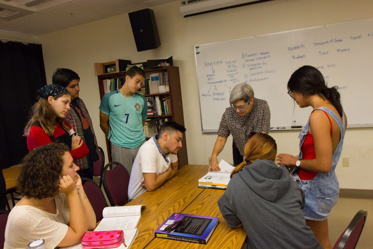 Instructor Camille Elam showing her students what a production book looks like and what it would contain Monday, Sept. 18, 2017 in Drama/Music Room 134 in City College in Santa Barbara, Calif. Students will design a whole play with images, references and sketches for a play called