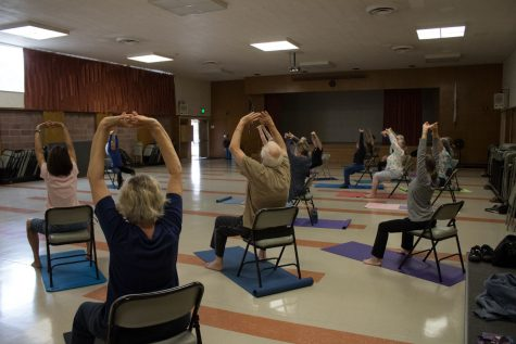 All ages and stages yoga class working on arm flexibility by copying teacher Fredda Spirka Tuesday, Sept. 12, in Wake Campus Room 33 in Santa Barbara. Spirka's class meets every Tuesday from 9:30 to 10:30 a.m.