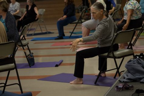 "All ages and stages gentle yoga student Sharan Crandall, 77, imitating her instructors arm movements Tuesday, Sept. 12, in Wake Campus Room 33 in Santa Barbara.""It's helped me definitely in my general fitness,"" Crandall said. ""I'm quite old and it's kept me young."""